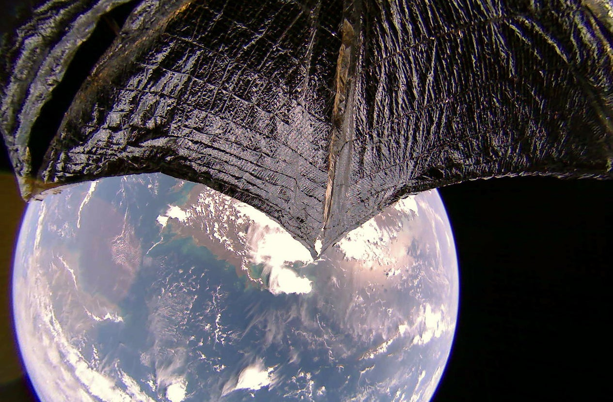 lightsail 2's wing in the foreground, Earth and Australia in the background