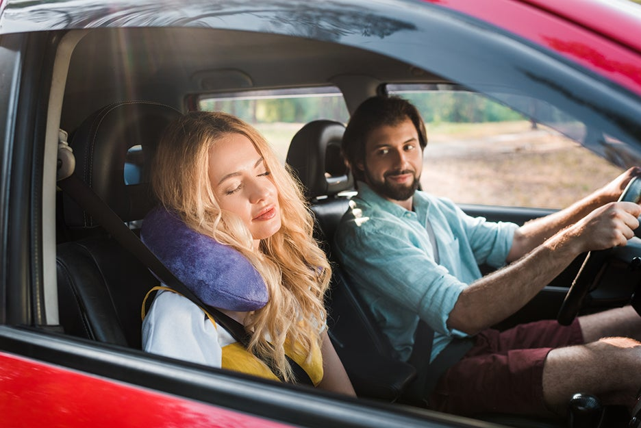 guy and girl driving in a car
