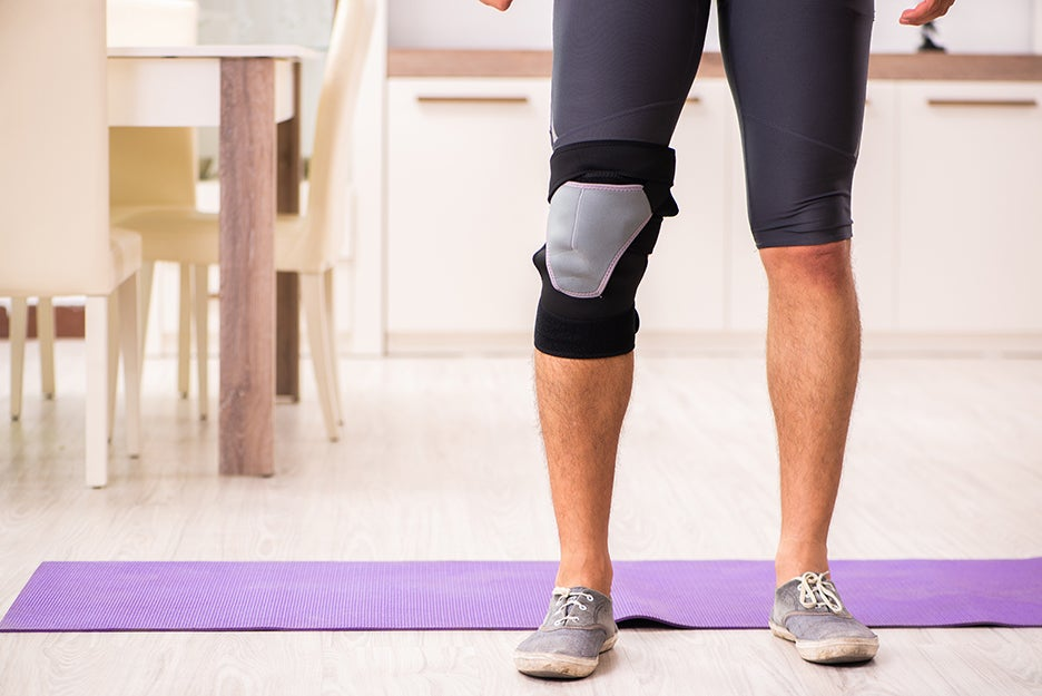 man with brace on knee