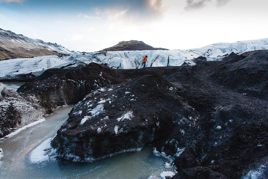 man walking across mountain