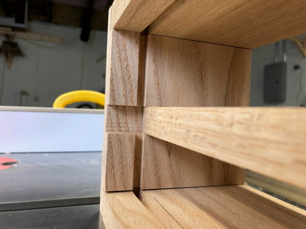 the rabbet and dado joints holding the oak key cabinet shelf organizer together