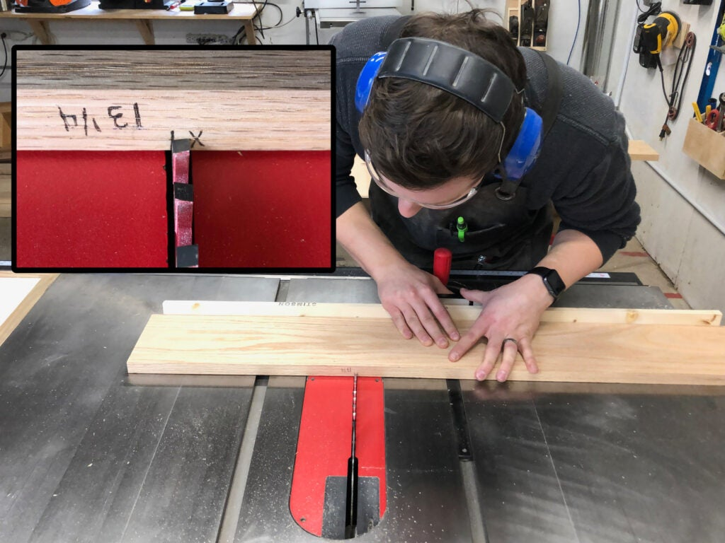 a person using a table saw to cut a piece of oak wood, with an inlaid image of markings on the wood showing which side is waste