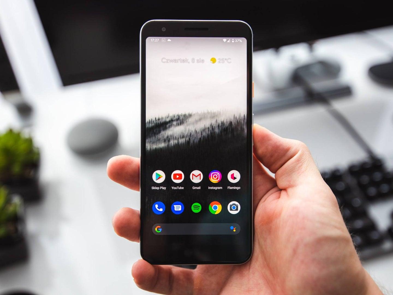 Hand holding Google Pixel phone