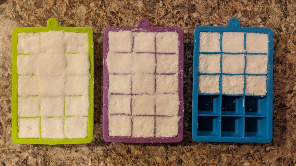 Silicone ice cube trays filled with detergent