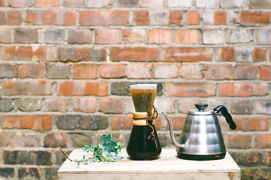 chemex coffee maker and kettle on a table