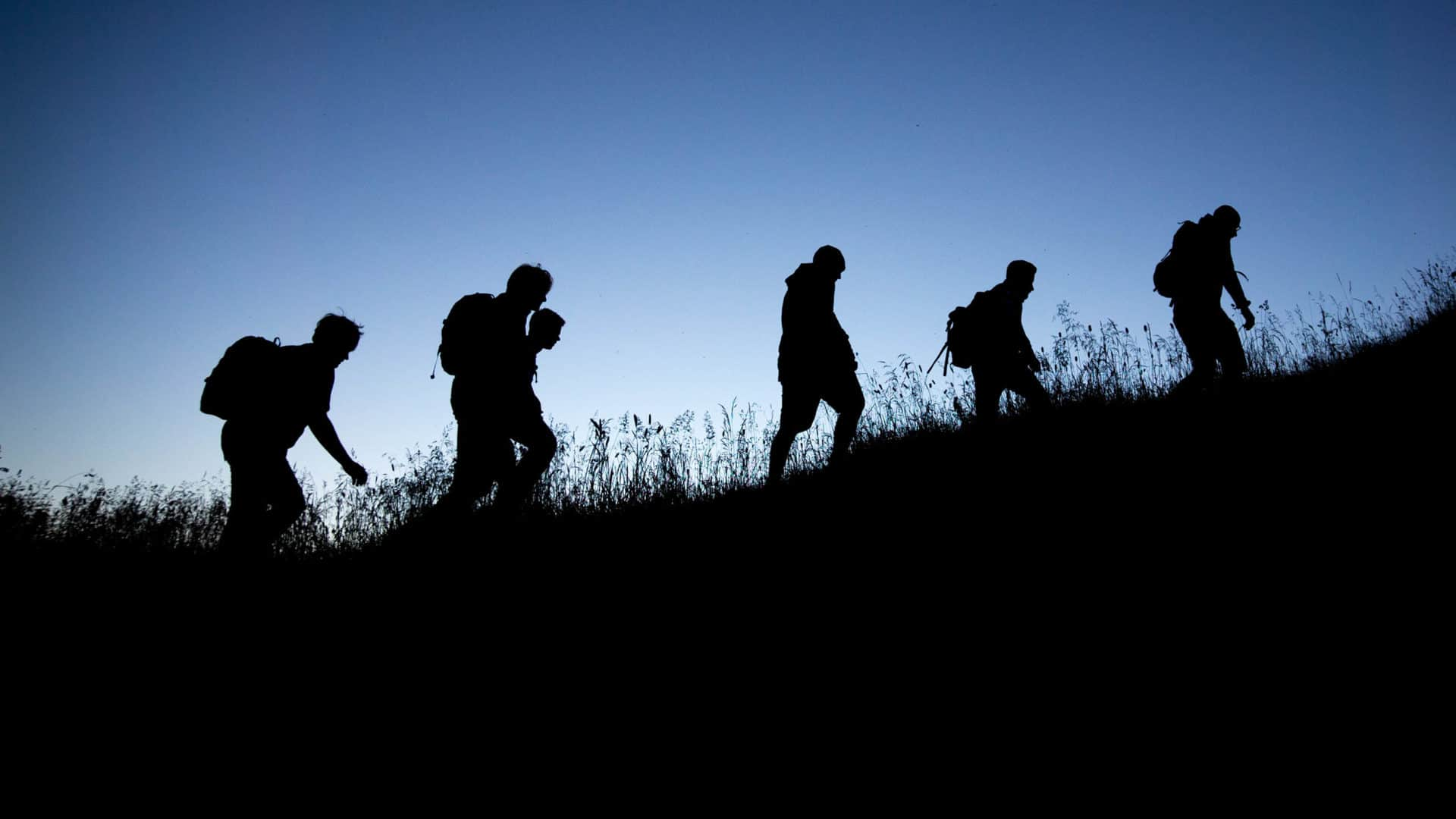 People climbing up a hill