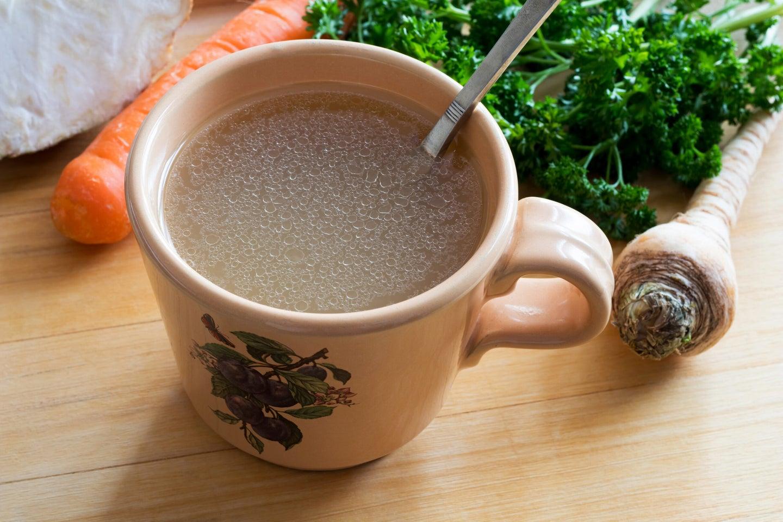 Chicken broth in a mug.