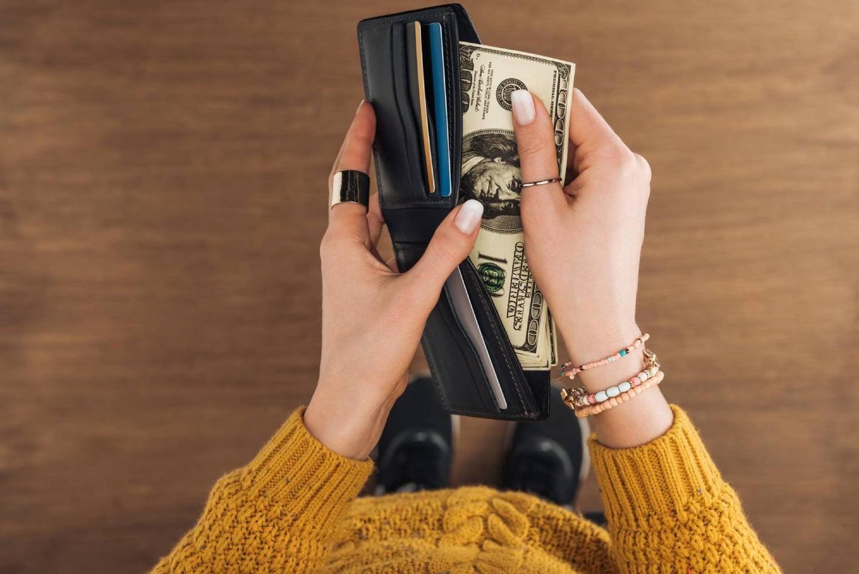 Hands holding an open wallet