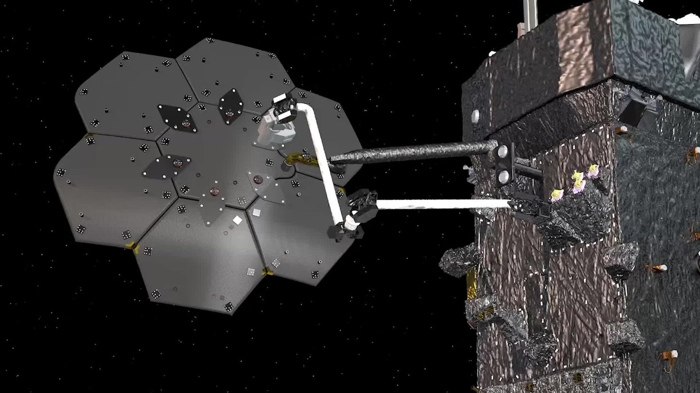 A robotic arm putting together an antenna in space