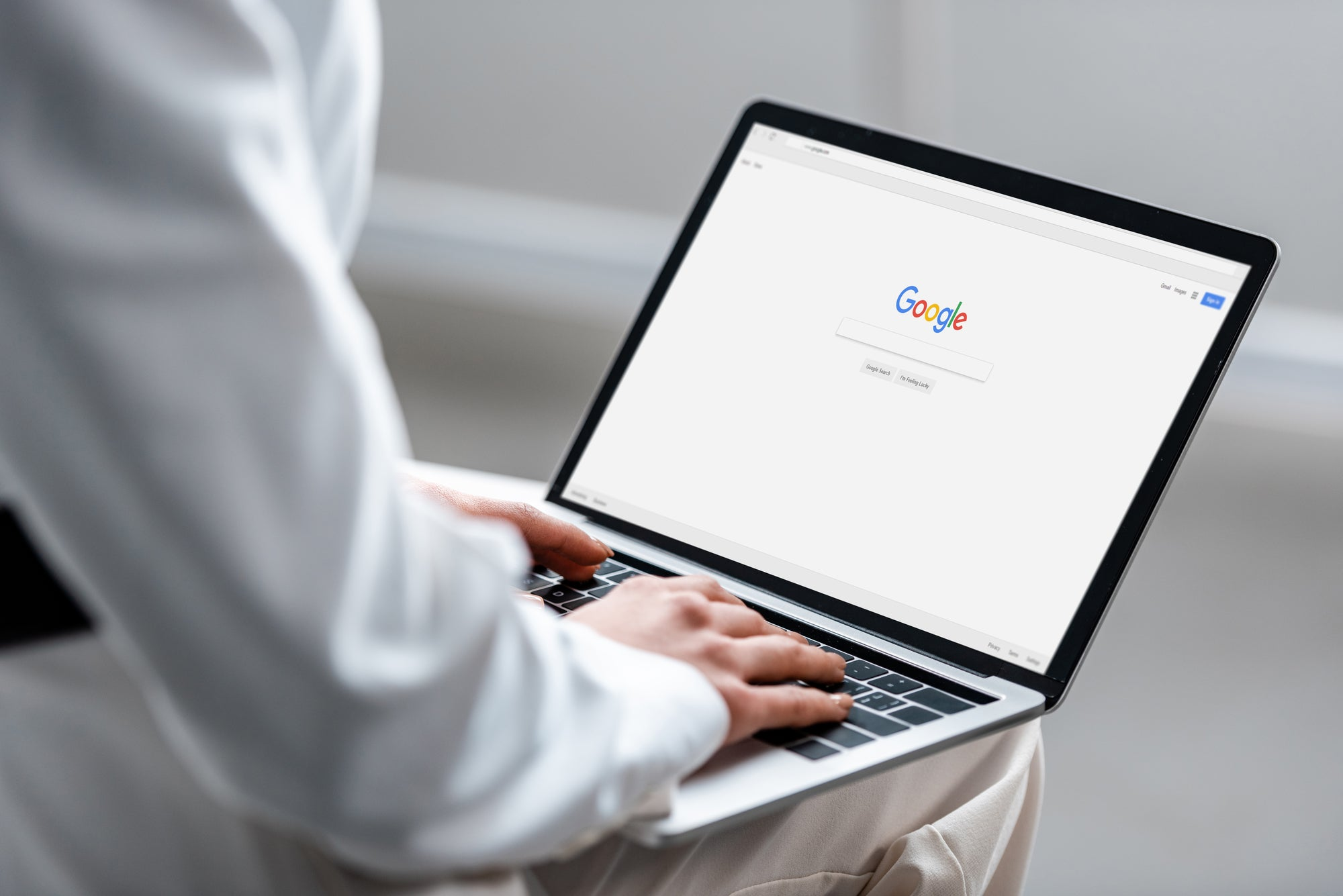 Person googling on laptop