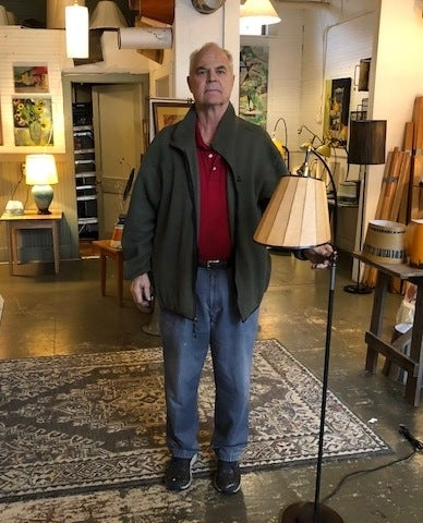 Ken Blaisdell, owner of Lampscapes, in White River Junction, Vermont, with his Brakelight lamp, which is made with a brake rotor as its base