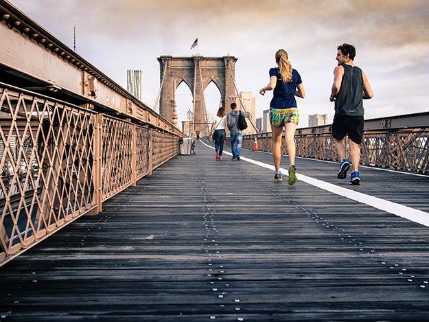 people running on a bridge