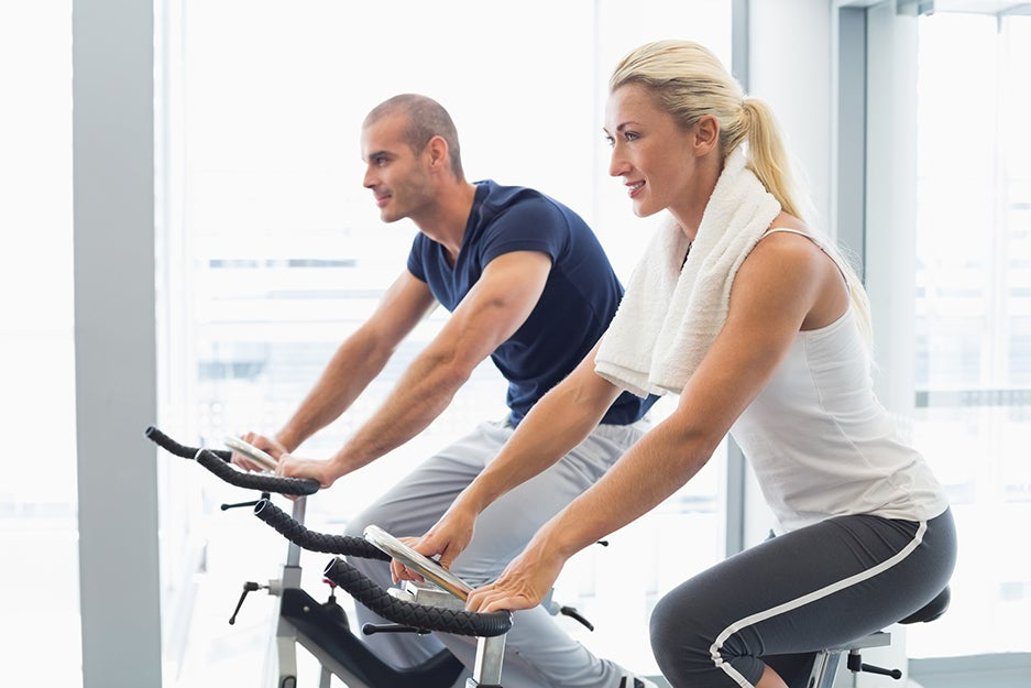 two people on stationary bikes