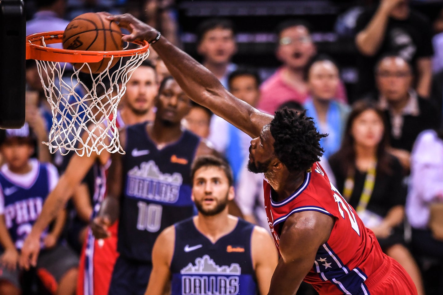 Joel Embiid of the Philadelphia 76ers pulls his 7-foot frame into a well-balanced dunk form.