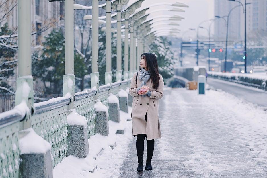woman walking down a snowy street
