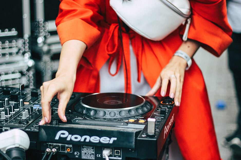 person in front of a DJ booth
