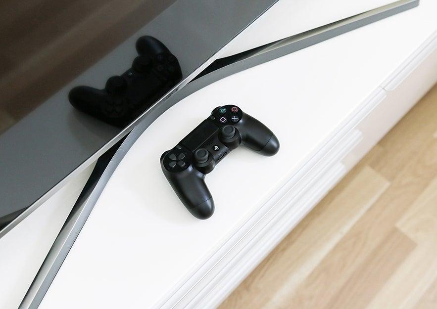 PS4 controller near a TV