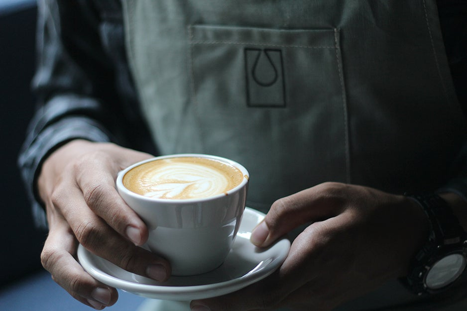 person holding a latte