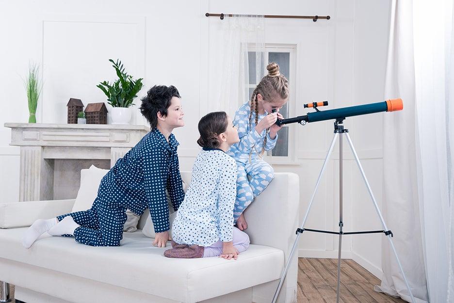 kids looking through a telescope