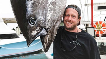 Captain Jake Hiles and 708-pound tuna that is the pending new state Virginia record.