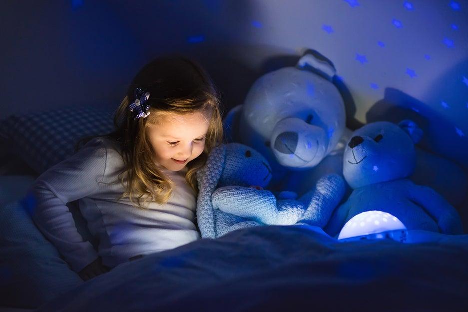 kid with night light
