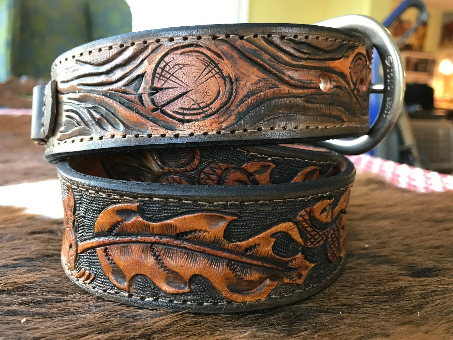 a photo of custom leatherwork on a coiled belt