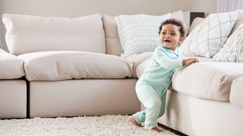 baby walking in living room