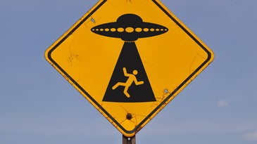 A road sign warning of possible alien abduction