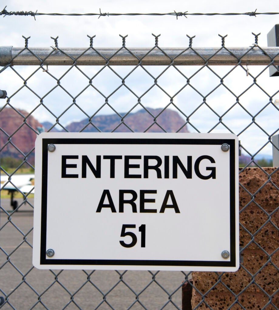 A fence sign for Area 51