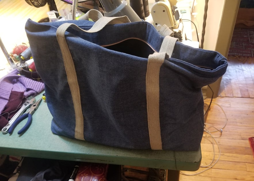 a DIY zippered tote bag made out of recycled fabric