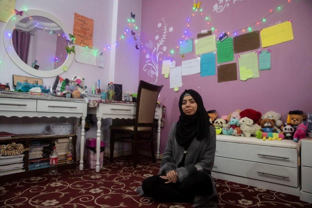 Mirna al-Sabbah, who dreams of becoming an astrophysicist, in her bedroom