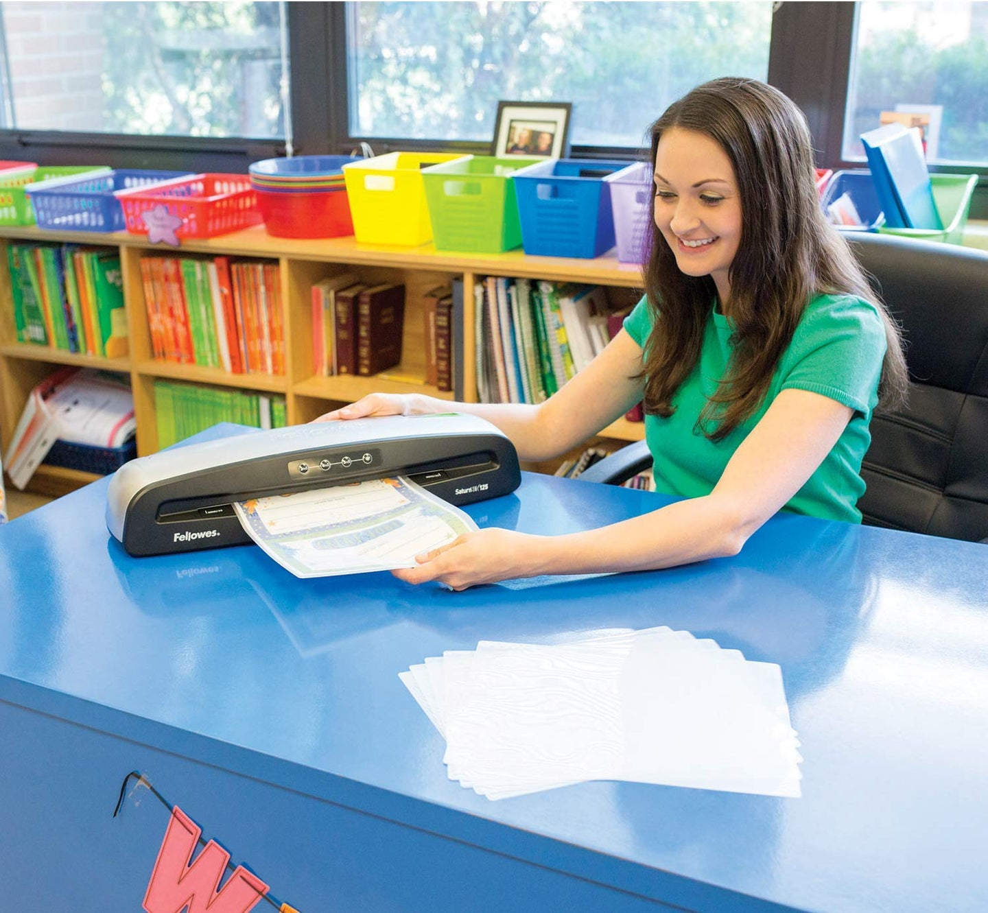 woman laminating pages