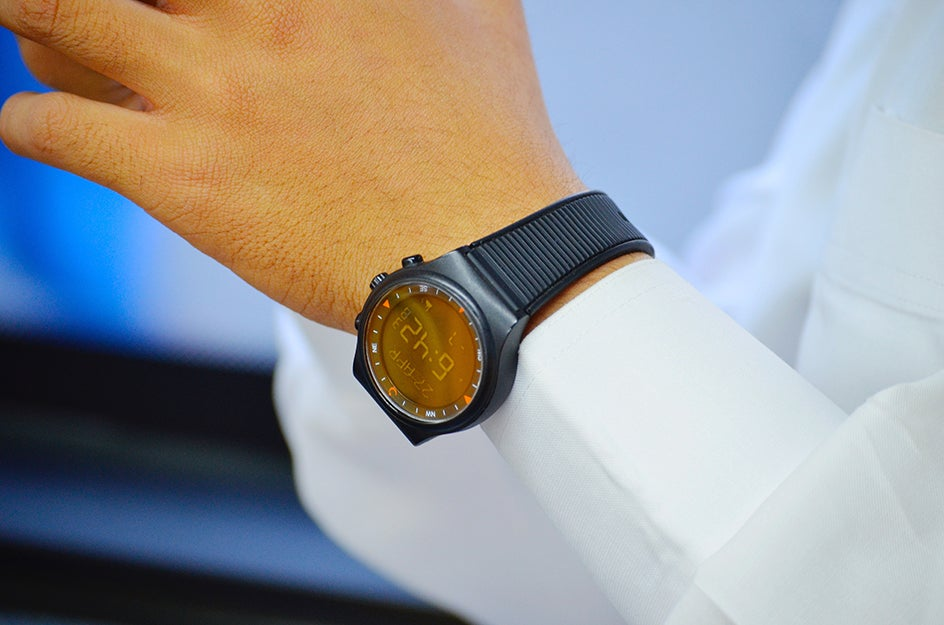 person with digital watch on wrist