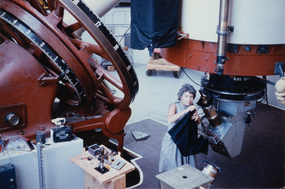 Vera Rubin adjusts a telescope at the Lowell Observatory in Flagstaff, Arizona.