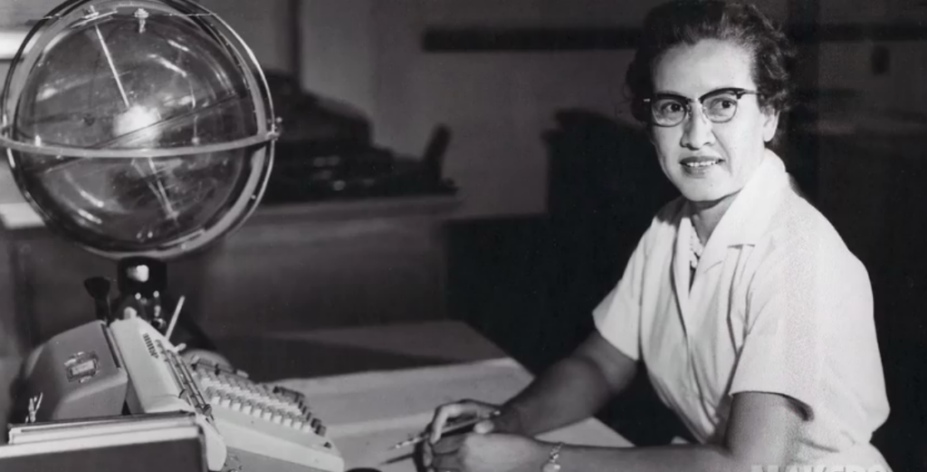 NASA computer Katherine Johnson sits at her desk.