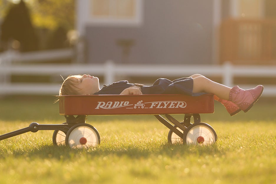 kid laying down in a wagon