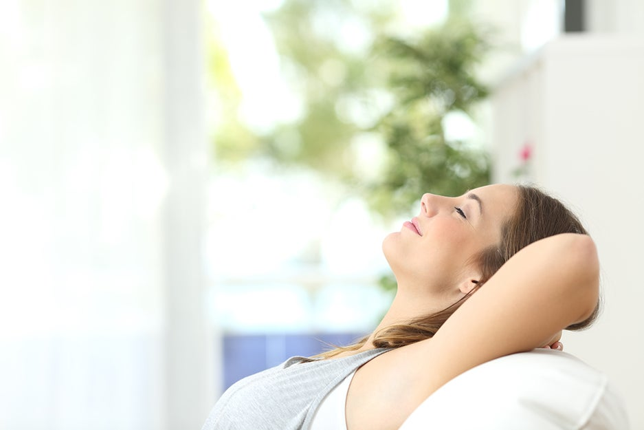 woman laying back on a couch