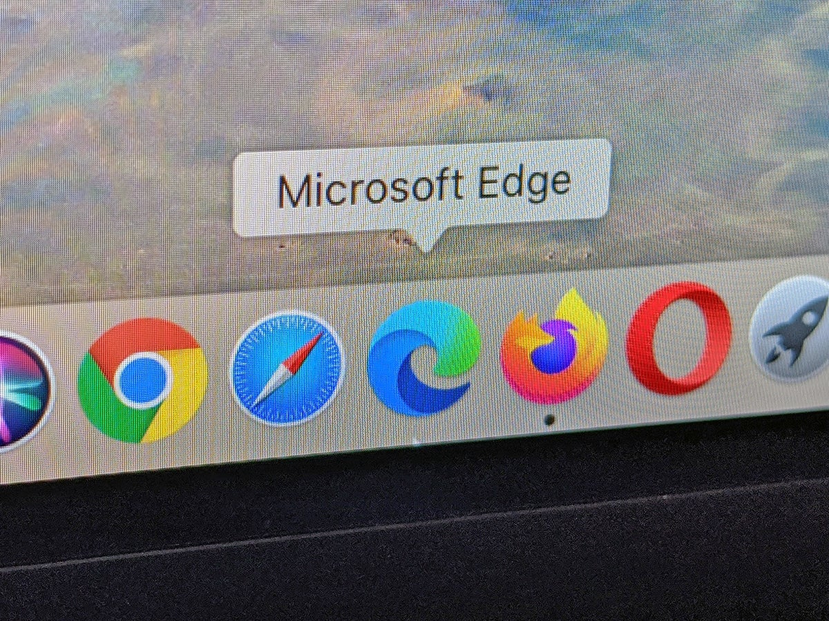 a photo of an Apple Mac laptop screen with the web browsers Google Chrome, Safari, Microsoft Edge, Mozilla Firefox, and Opera all in the task bar