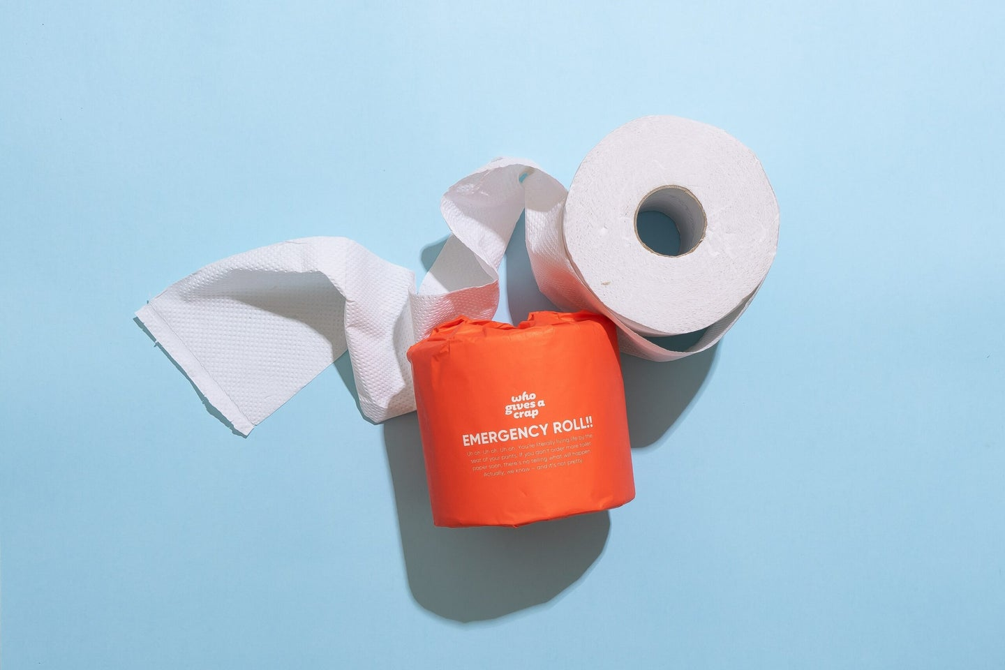 """A roll of toilet paper labeled as """"emergency"""""""