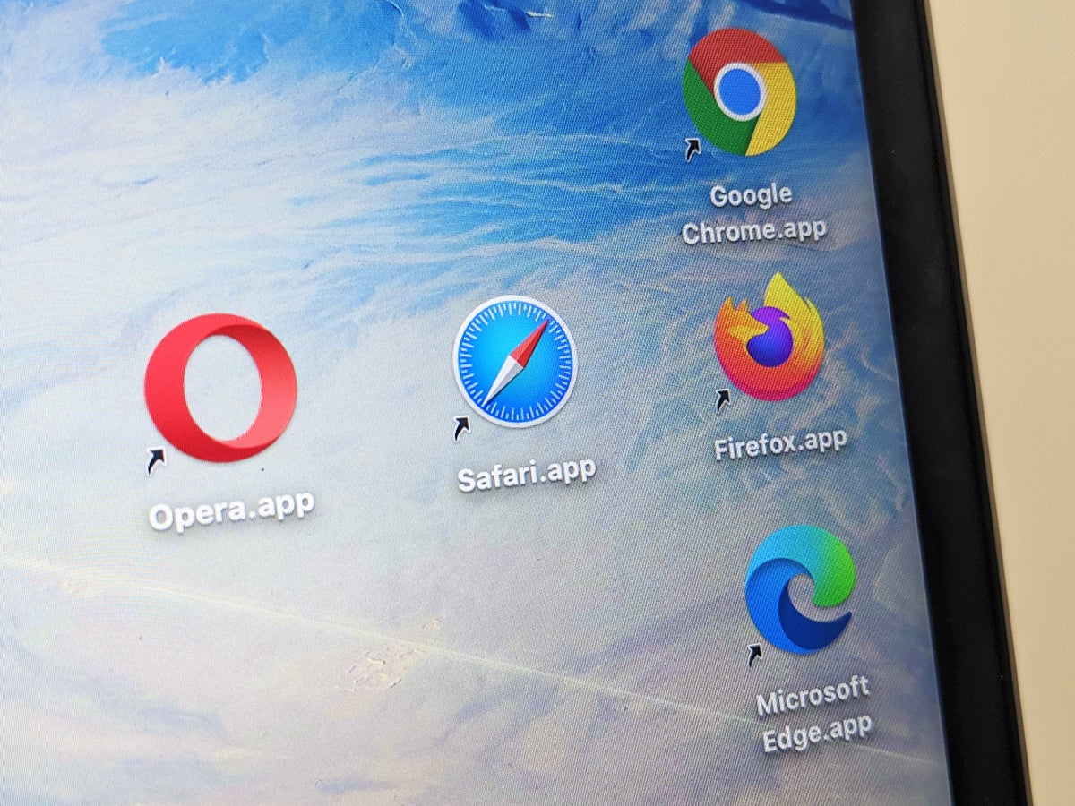 a photo of a laptop screen with shortcuts to web browsers Google Chrome, Apple's Safari, Mozilla Firefox, Microsoft Edge, and Opera