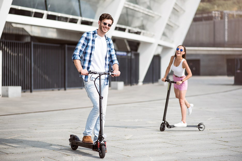 two people on electric scooters