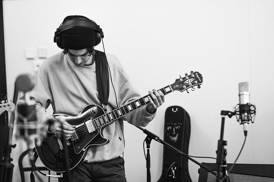 guitarist with headphones