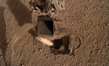 At long last, NASA's probe finally digs in on Mars