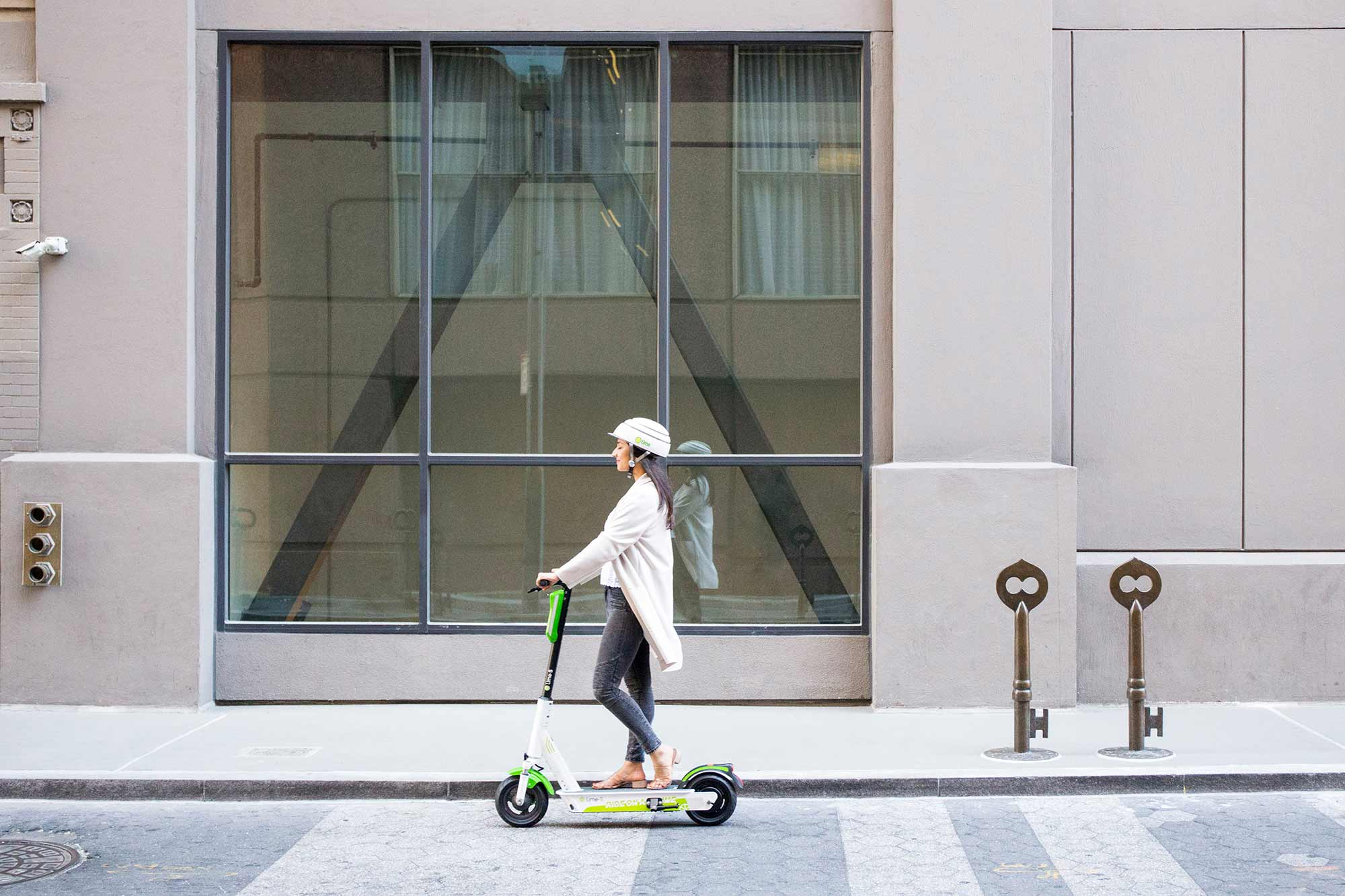 Woman riding a Lime scooter