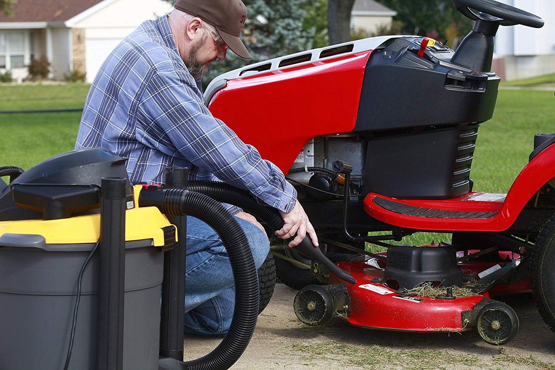 man vacuuming outdoors