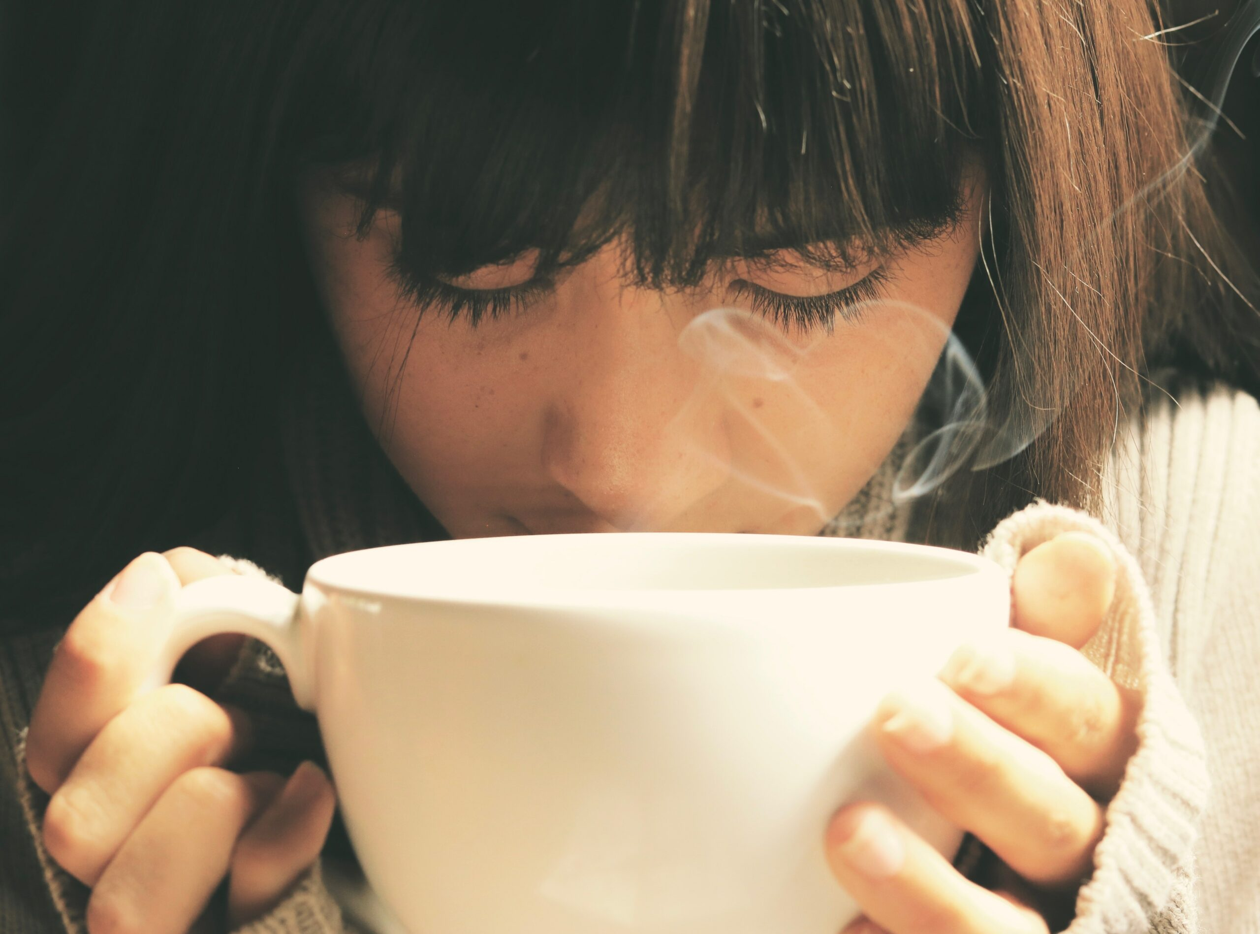 person smelling coffee