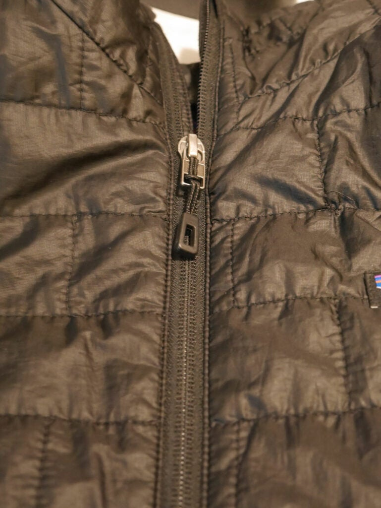 a brown winter jacket with a zipper that needs to be lined up for proper replacement