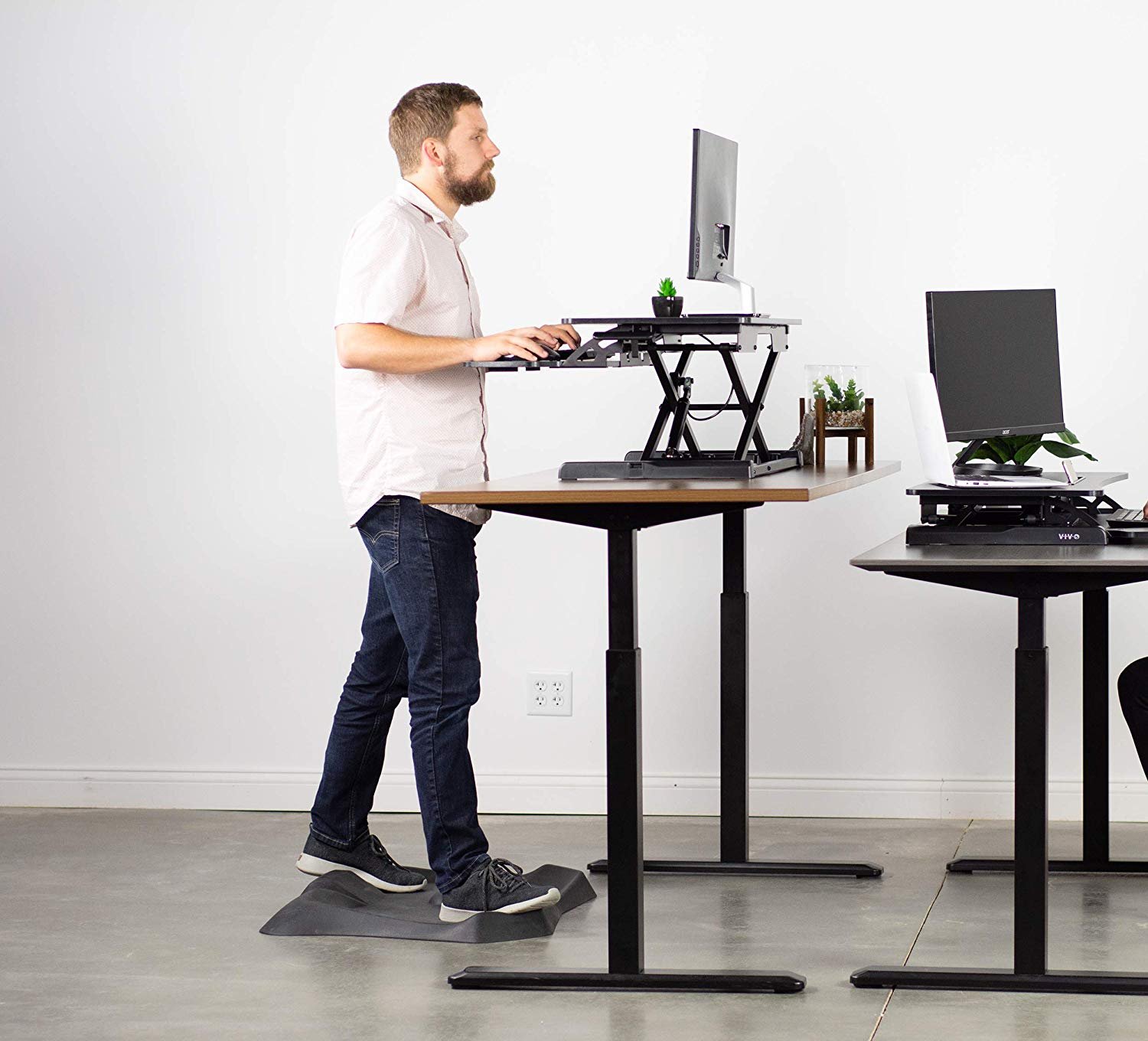 person standing at a desk