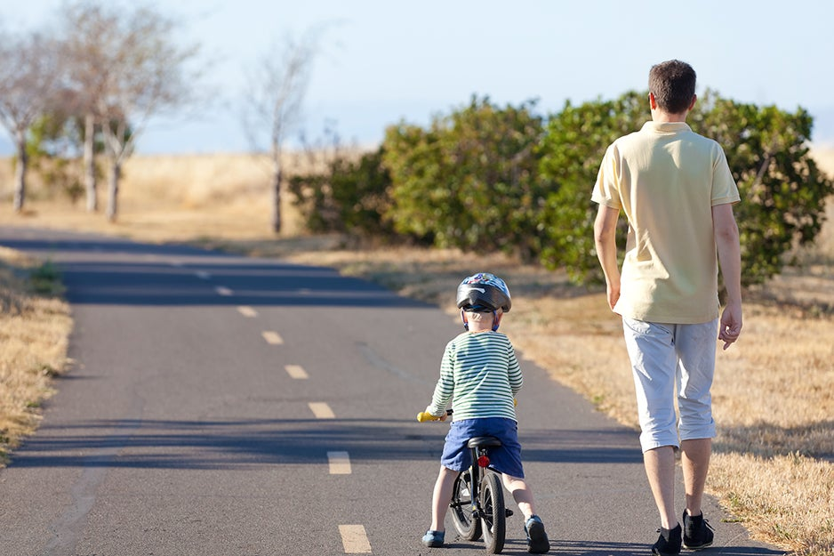 kid and parent with bike