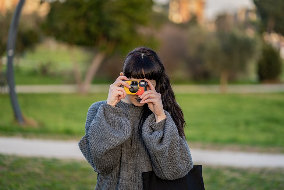 person with disposable camera